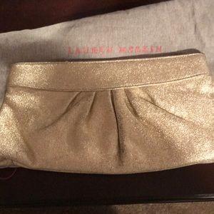 Beautiful gold clutch by Lauren Merkin!